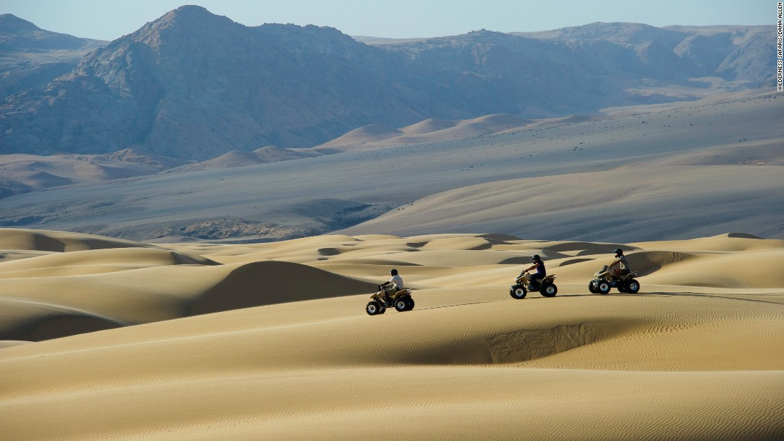 "Ever wanted to indulge your inner Mad Max? In the wild north-west of Namibia, visitors to the remote Serra Cafema Camp can hop on a quadbike and traverse the Namib Desert. The tours, operated by <a href=""http://www.wilderness-safaris.com/camps/serra-cafema-camp"" target=""_blank"">Wilderness Safaris</a>, negotiate the area's imperious dunes whilst offering the chance to meet the Himba community, a semi-nomadic group local to the Hartmann Valley."