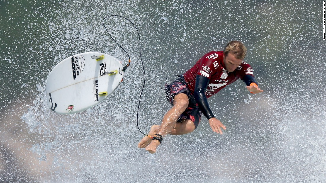 Australian surfer Josh Kerr is separated from his board while competing in Rio de Janeiro on Friday, May 15.