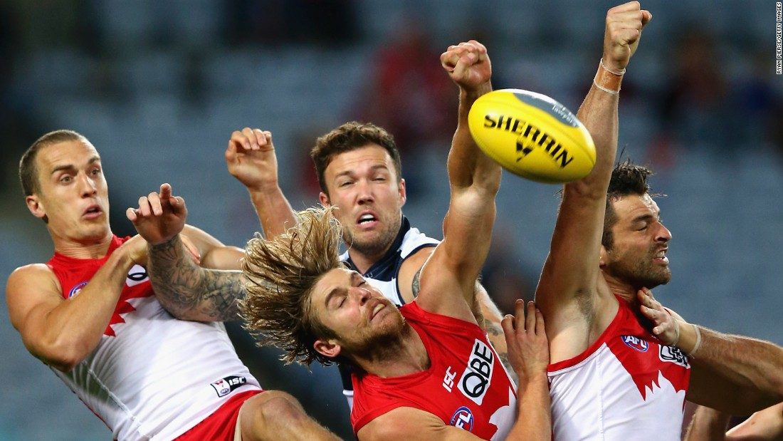 Three of the Sydney Swans -- from left, Ted Richards, Dane Rampe and Heath Grundy -- compete for the ball against Mitch Clark of the Geelong Cats during an Australian Football League match on Saturday, May 16.