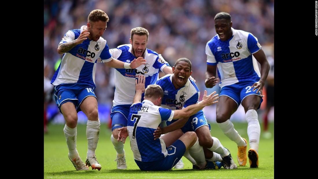 Players from Bristol Rovers run to teammate Lee Mansell after he scored the winning penalty in the shootout against Grimsby Town on Sunday, May 17. The playoff victory in London earned the Rovers a spot in League Two, which is the fourth tier of English soccer.