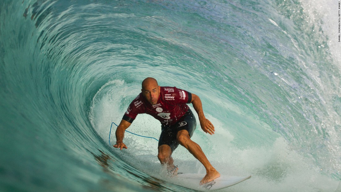 American surfer Kelly Slater ducks under a wave during a competition in Rio de Janeiro on Tuesday, May 12.