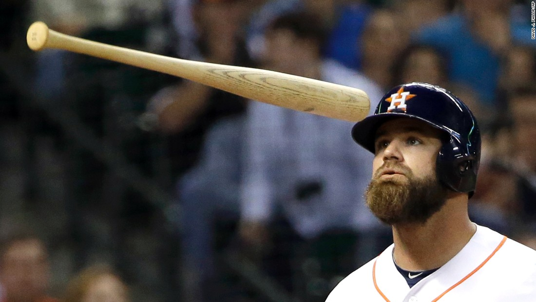 Houston's Evan Gattis tosses his bat after striking out Wednesday, May 13, in a home game against the San Francisco Giants.