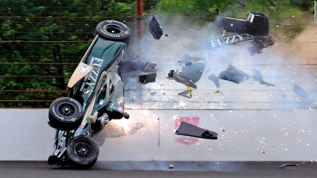 Ed Carpenter hits the wall Sunday, May 17, during a practice run for the Indianapolis 500. Carpenter walked away from the crash and was released from the track hospital.