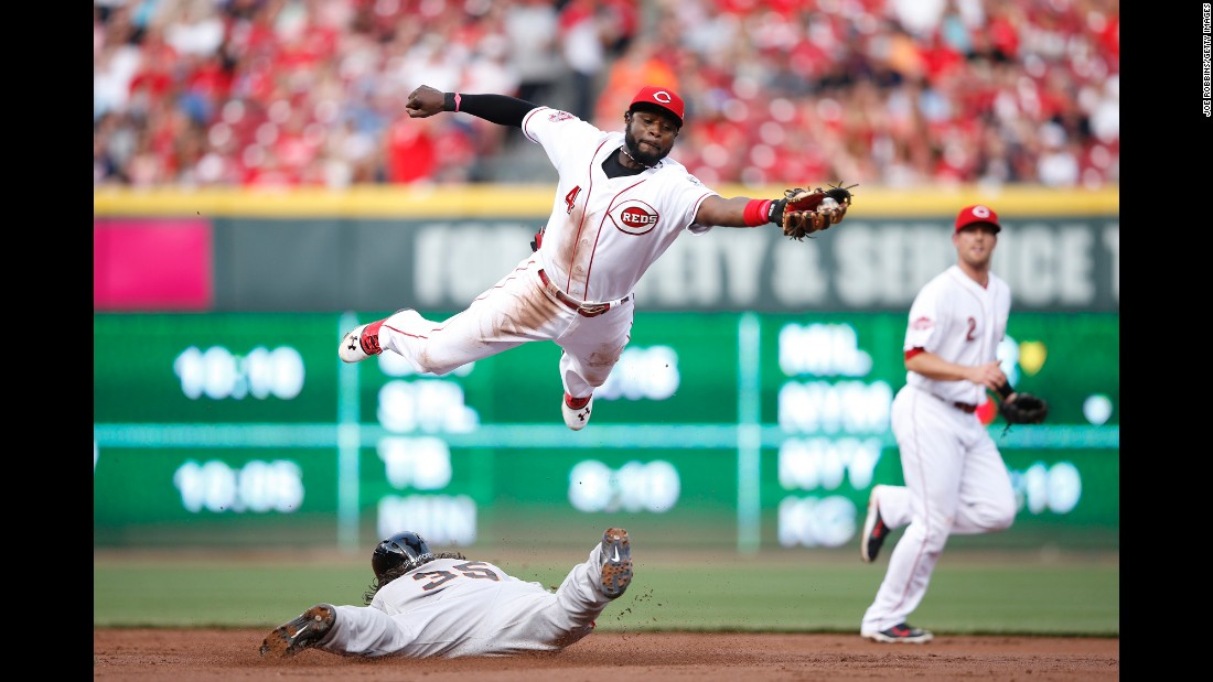 Cincinnati's Brandon Phillips leaps over San Francisco's Brandon Crawford as Crawford steals second base Friday, May 15, in Cincinnati.
