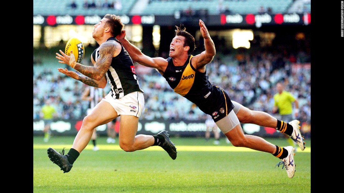 Jamie Elliott of the Collingwood Magpies takes a mark in front of Alex Rance of the Richmond Tigers during an Australian Football League match on Sunday, May 17.