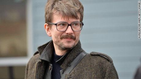 Charlie Hebdo cartoonist Renald Luzier (L) aka 'Luz' after the funeral service of Charlie Hebdo editor and cartoonist Stephane Charbonnier aka 'Charb' in his hometown on January 16, 2015 in Pontoise, France. Charlie Hebdo's editor Stephane Charbonnier was amongst those killed in the terrorist attack on the satirical newspaper.