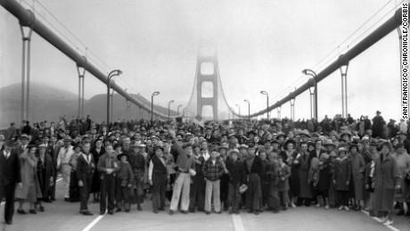 27 May 1937, San Francisco, California, USA --- Pedestrians walk across the Golden Gate Bridge on May 27, 1937 in San Francisco, Calif. --- Image by © San Francisco Chronicle/San Francisco Chronicle/Corbis
