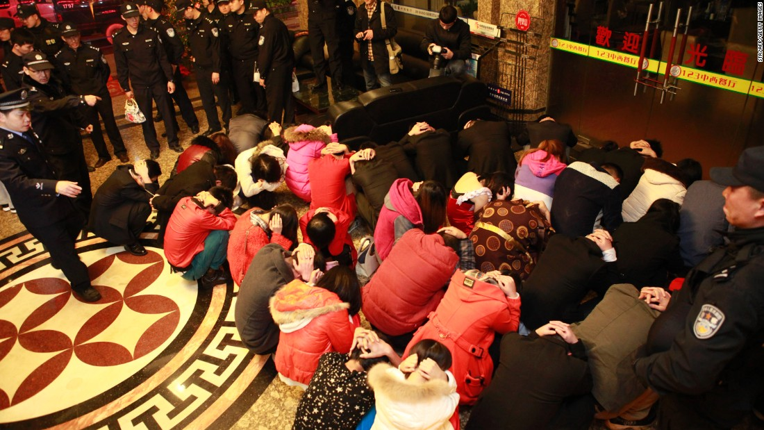 This picture taken on February 9, 2014 shows Chinese police rounding up alleged sex workers and clients. The raids lasted several months and their impact is still being felt more than a year later.