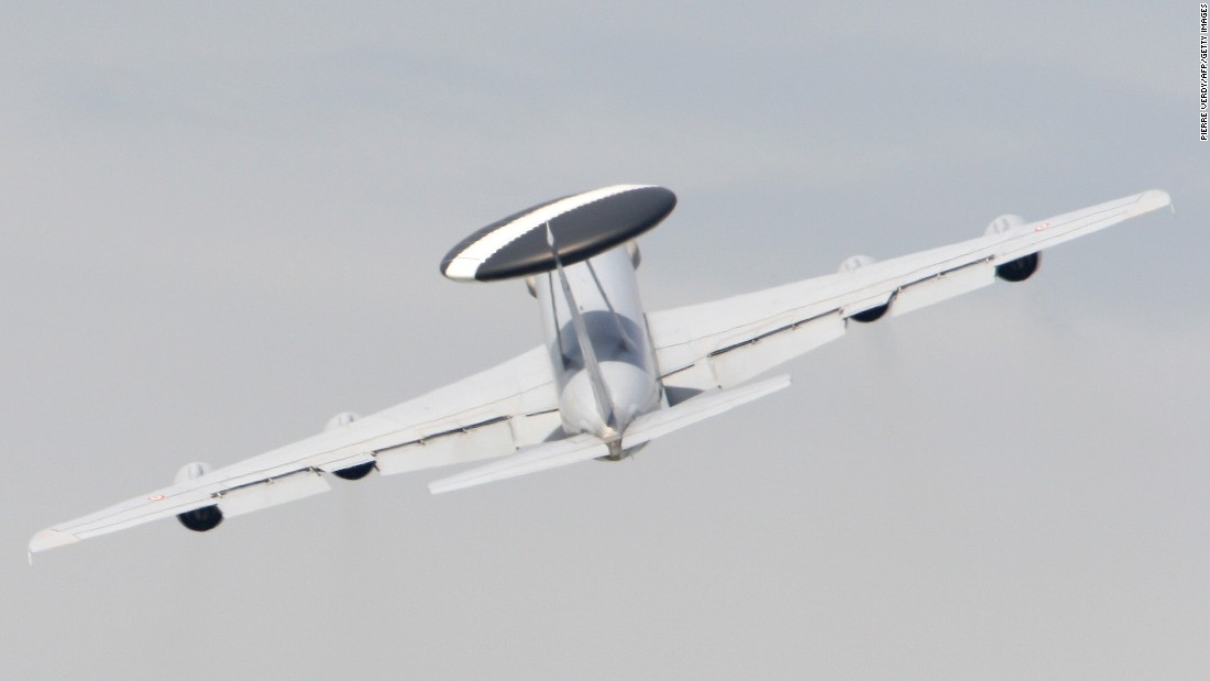 A Boeing E-3 Sentry AWACS performs a flying display at the 47th International Paris Air Show on the last day of the event in 2007. The plane is known for its distinctive rotating radar dome.
