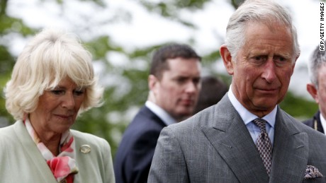 "Britain's Prince Charles, Prince of Wales (R) and Camilla, Duchess of Cornwall (L) after a service of peace and reconciliation at St Columba's Church in Drumcliffe, Ireland, on May 20, 2015. Britain's Prince Charles spoke of his ""anguish"" at the murder of his godfather by IRA paramilitaries in 1979 as he became the first royal to visit the assassination site in Ireland. Charles remembered Lord Louis Mountbatten as ""the grandfather I never had"" on an emotional trip to the rugged coastline, saying he understood the suffering of the Irish people in ""a profound way"". AFP PHOTO / POOL / BRIAN LAWLESSBRIAN LAWLESS/AFP/Getty Images"
