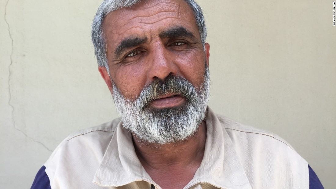 "Ali Hubeter, 49. Farmer. ""We found two kids in the rubble in Ainsheeb. The two-year-old lost his leg. We thought he wouldn't make it, but he is alive!"""
