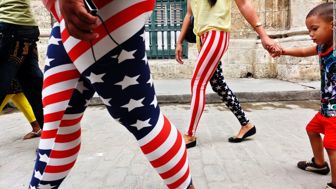 "Women wearing pants designed with the colors of the U.S. flag walk through Old Havana in Cuba in January. <a href=""/video/data/3.0/video/world/2015/05/20/pkg-oppmann-cuba-us-flag-popularity.cnn/index.xml"" target=""_blank"">Many Cubans say displaying U.S. flags makes them no less patriotic about their own country, according to Patrick Oppmann</a>, CNN's correspondent in Cuba. They have relatives in the States and a positive opinion of their neighbor to the north despite the antagonism between the U.S. and Cuban governments."