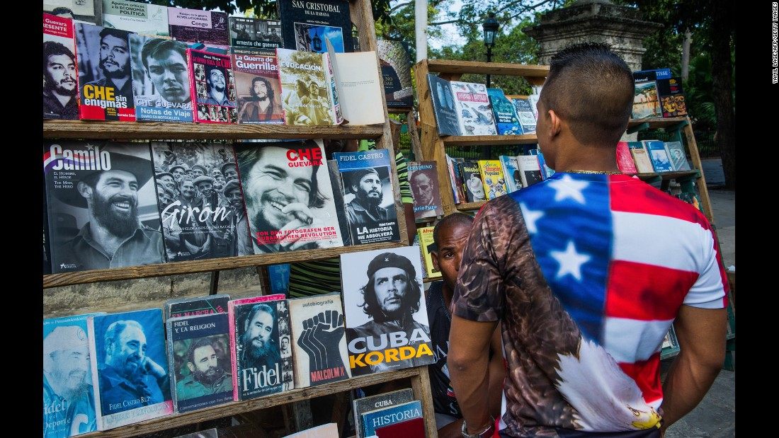 A man looks at a magazine stand in Havana in January.
