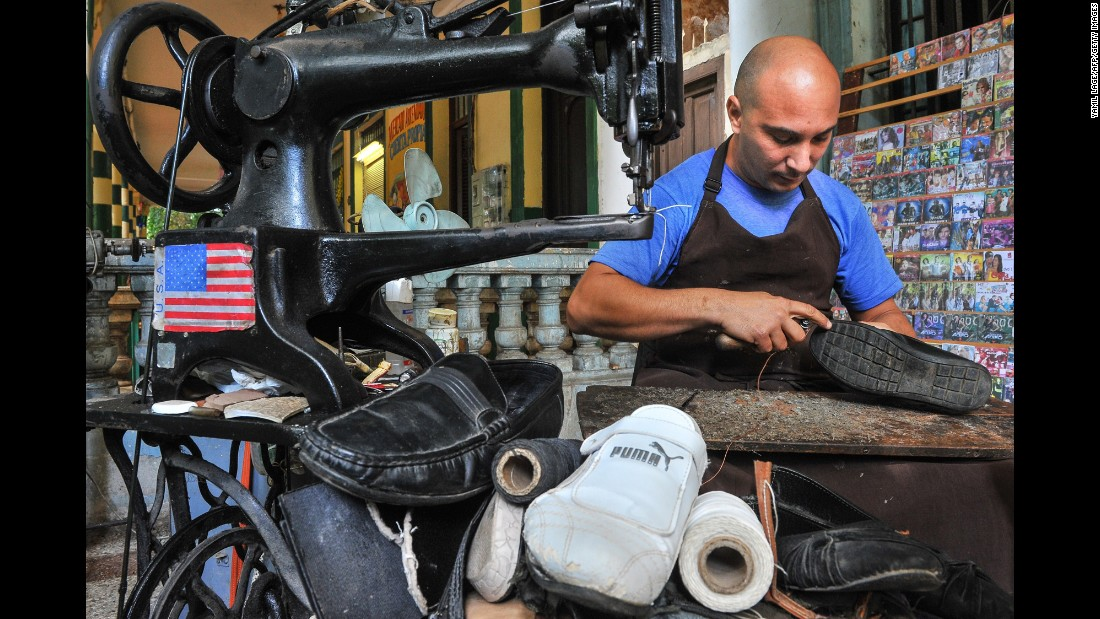 The American flag is displayed on a Havana cobbler's sewing machine in January.