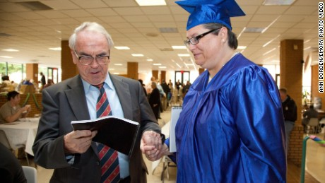 Kelly Gissander speaks with Jurgen Moltmann at her graduation ceremony.