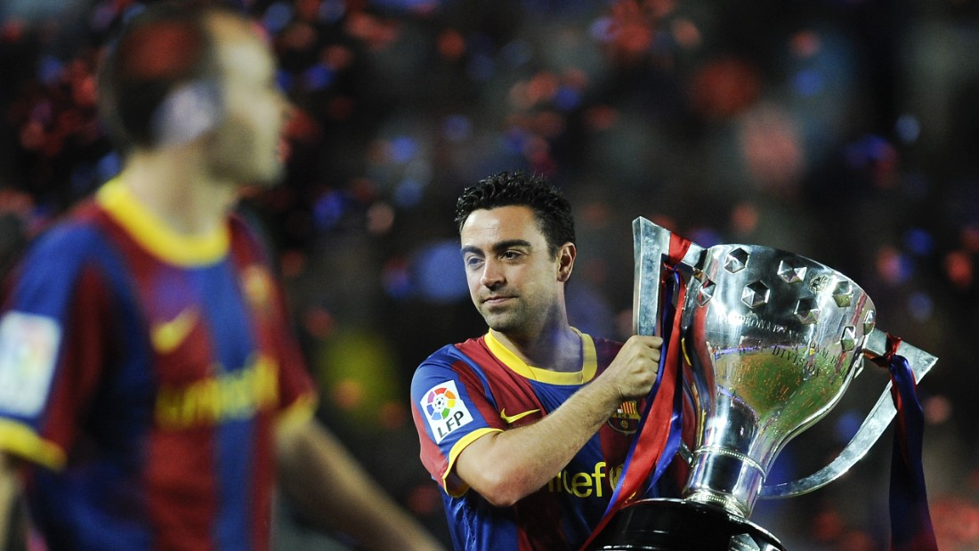150521143422-xavi-hernandez-spanish-league-trophy-super-169.jpg