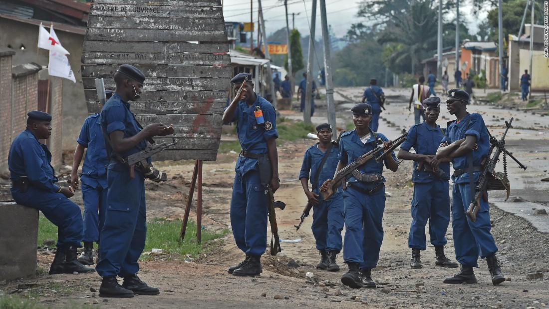 Police officers hold a position in Bujumbura on Wednesday, May 20.