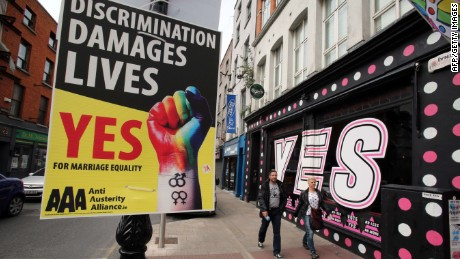 Pedestrians walk past a mural in favour of same-sex marriages in Dublin on May 21, 2015. Ireland goes to the polls tomorrow to vote on whether same-sex marriage should be legal, in a referendum that has exposed sharp divisions between communities in this traditionally Catholic nation. AFP PHOTO / PAUL FAITHPAUL FAITH/AFP/Getty Images