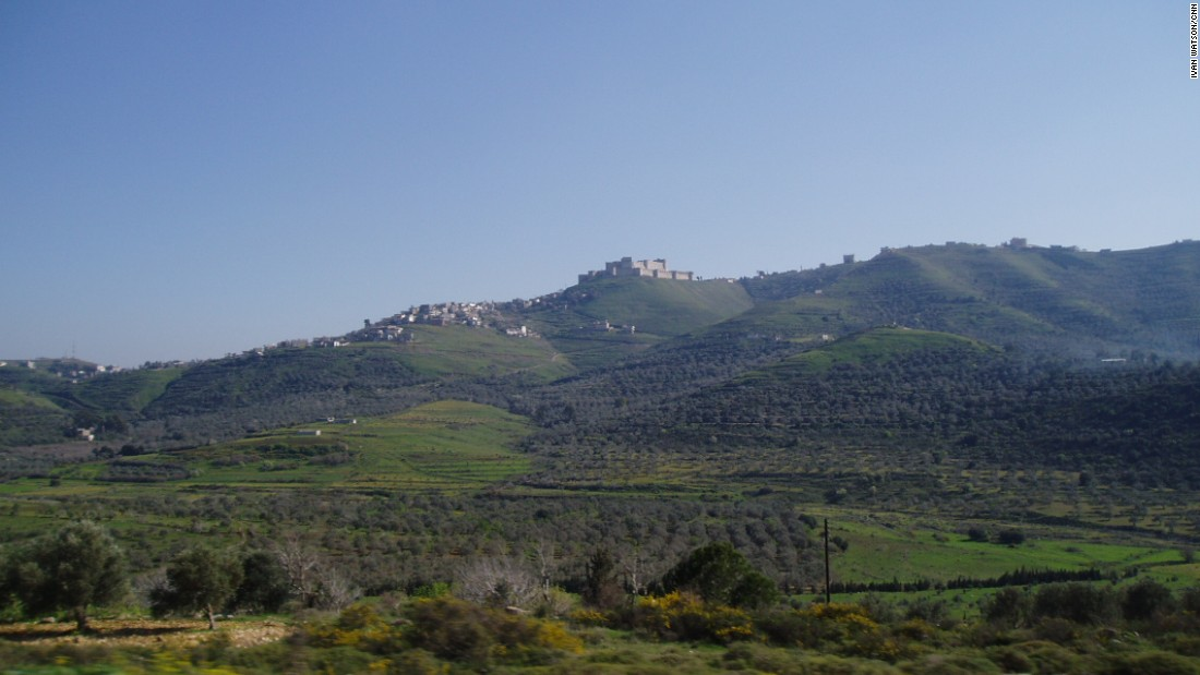The Crac de Chavaliers is pictured from afar on a hilltop.