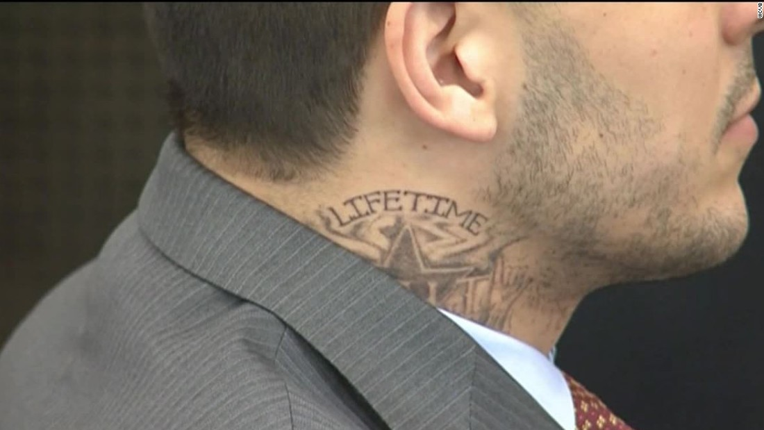 Aaron hernandez in court with new neck tattoo cnn video for Aaron hernandez neck tattoo meaning