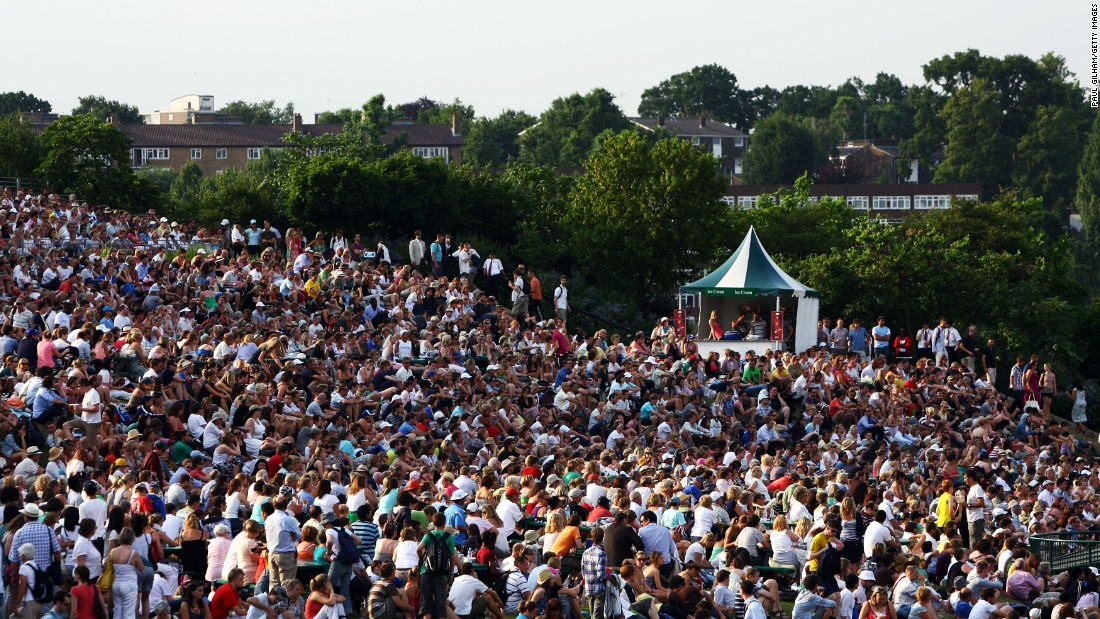 "Fans gather near giant screens on ""Murray Mount"" as their hero takes on Stan Wawrinka of Switzerland in a fourth round match in 2009."