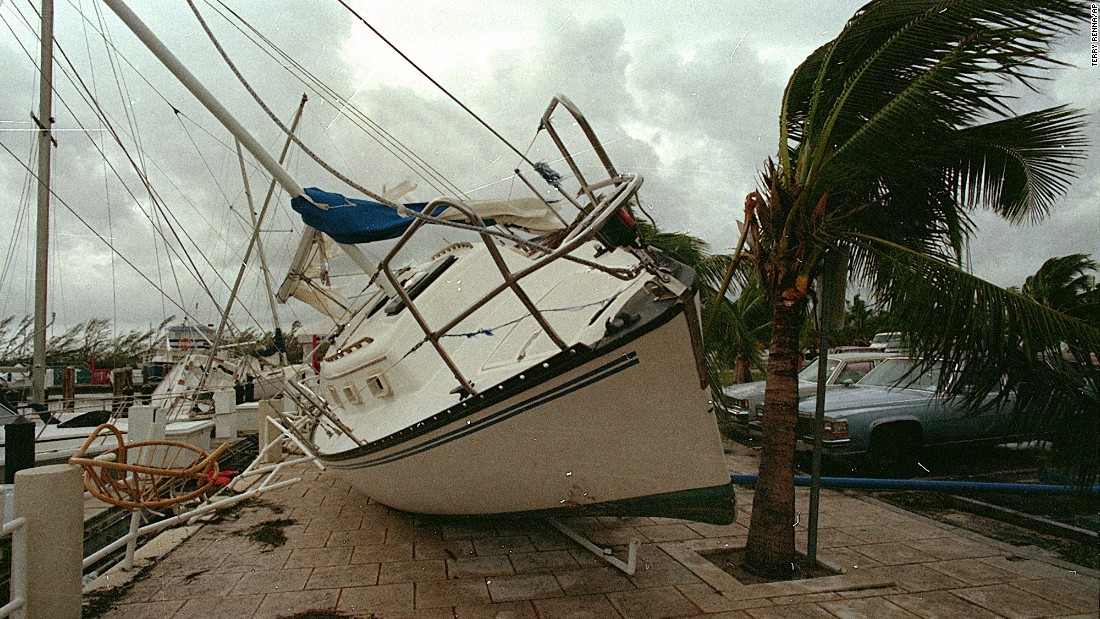 "<strong>Andrew, 1992</strong>: <a href=""http://www.srh.noaa.gov/mfl/?n=andrew"" target=""_blank"">Andrew</a> blasted its way across south Florida on August 24 as a Category 4 with peak gusts measured at 164 mph. After raking entire neighborhoods in an around Homestead, it moved across the Gulf to hit Louisiana as a Category 3. It was responsible for 23 U.S. deaths and three in the Bahamas. Here, a sailboat sits on a sidewalk at Dinner Key in Miami after Andrew washed it ashore."