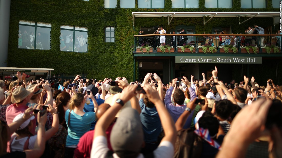 When his moment of glory arrived, Andy Murray took to the Centre Court balcony to display the trophy to throngs of fans gathered outside.