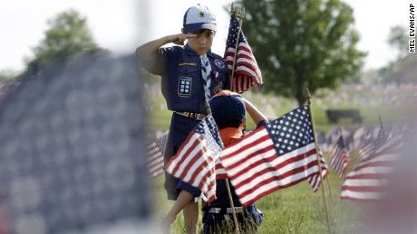 Cub Scout Tristan Swanhart, 8,of Cookstown, New Jersey, salutes after placing a flag on a grave at Brig. Gen. William C. Doyle Veterans Memorial Cemetery in Wrightstown, New Jersey, on May 22.