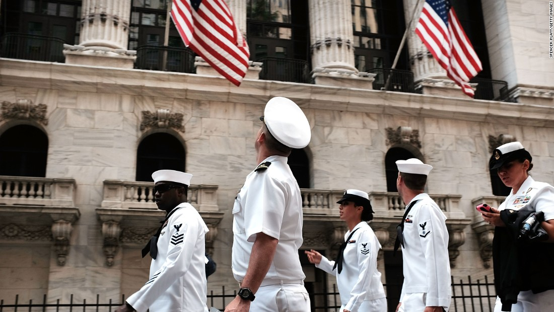 Sailors in New York walk through Lower Manhattan on May 22.