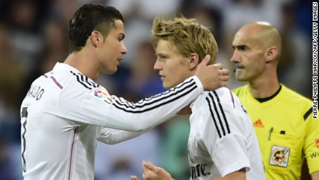 Real Madrid's Portuguese forward Cristiano Ronaldo (L) is substituted by Real Madrid's Norwegian midfielder Martin Oedegaard during the Spanish league football match Real Madrid CF vs Getafe CF at the Santiago Bernabeu stadium in Madrid on May 23, 2015. AFP PHOTO / PIERRE-PHILIPPE MARCOU (Photo credit should read PIERRE-PHILIPPE MARCOU/AFP/Getty Images)