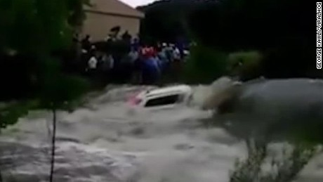 Powerful flood sweeps SUV away