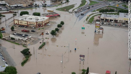 A shopping center submerged in water from the Blanco River flooding in San Marcos,Texas, on Sunday, May 24.