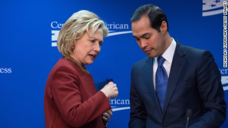 Former US Secretary of State Hillary Clinton talks with Housing and Urban Development Secretary Julian Castro after taking part in a discussion on 'our nation's urban centers,' and 'challenges from housing and transportation to education and workforce accessibility' at the Center for American Progress (CAP) in Washington, DC, on March 23, 2015.