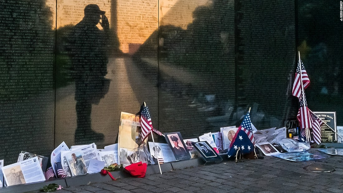 Army veteran Bernie Klemanek stops to salute his fallen comrades during an early morning visit to the Vietnam Veterans Memorial in Washington on May 25.
