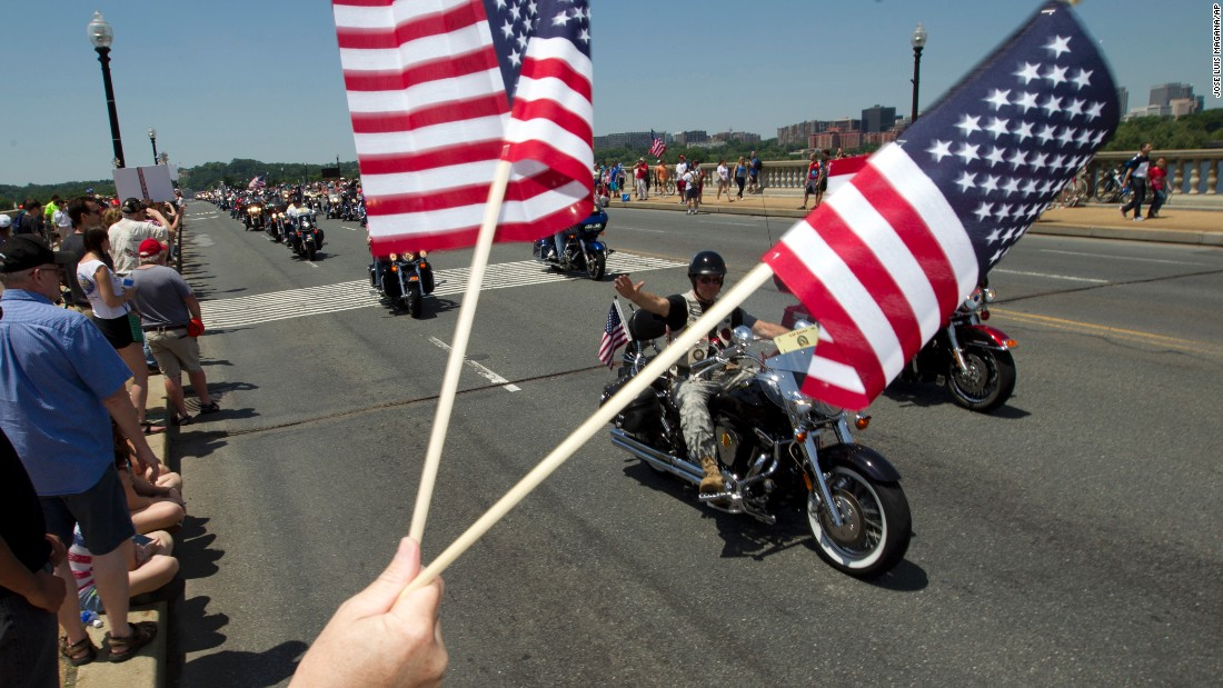 People ride past Arlington Memorial Bridge in Washington during the annual Rolling Thunder motorcycle rally on May 24.