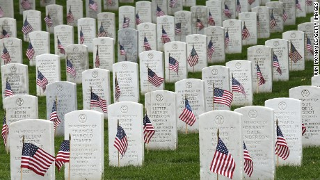 American flags are shown after being placed by members of the 3rd US Infantry Regiment at the graves of US soldiers buried at Arlington National Cemetery, in preparation for Memorial Day May 21, 2015 in Arlington, Virginia. 'Flags-In' has become an annual ceremony since the 3rd US Infantry Regiment (The Old Guard) was designated to be an Army's official ceremonial unit in 1948.