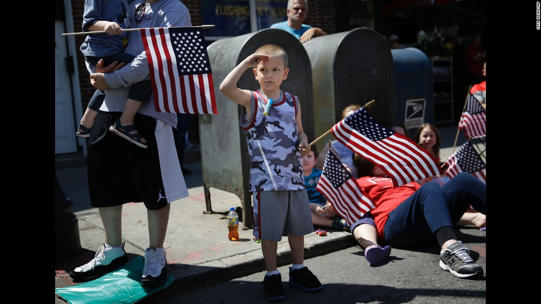 Rocco Struncius salutes as soldiers walk by during a Memorial Day parade in New York on May 25.