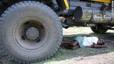 An Indian man rests under a transport vehicle on the outskirts of Hyderabad on May 25, 2015. More than 430 people have died in two Indian states from a days-long heatwave that has seen temperatures nudging 50 degrees Celsius (122 degrees Fahrenheit), officials said May 25. Officials warned the toll was almost certain to rise, with figures still being collected in some parts of the hard-hit Telangana state in the south of the country, and with no end in sight to the searing conditions. AFPHOTO/ Noah SEELAMNOAH SEELAM/AFP/Getty Images