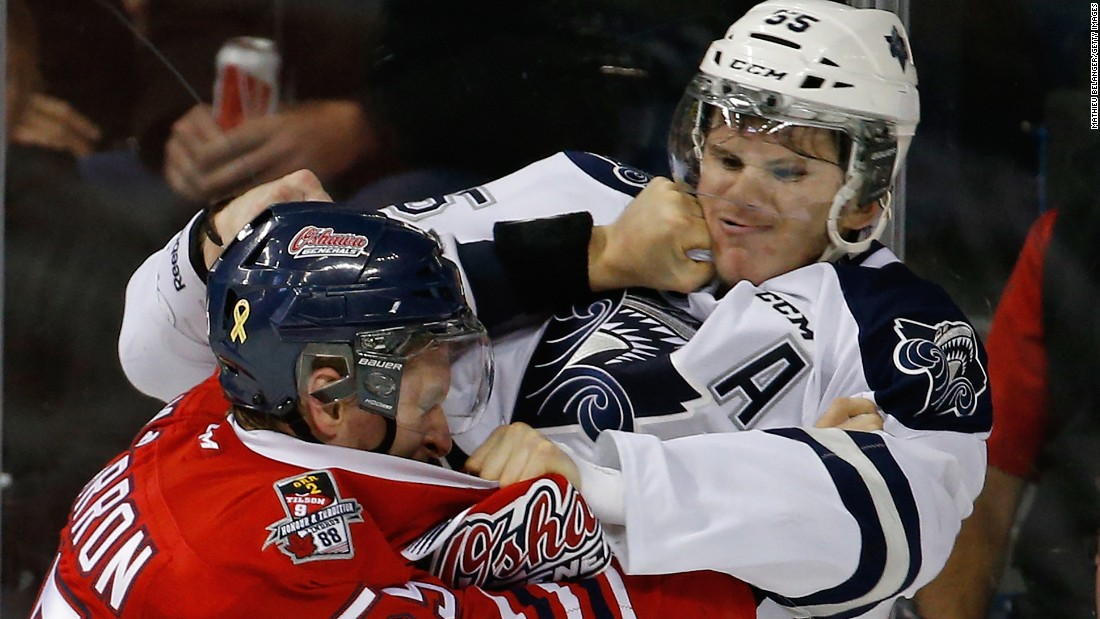 Oshawa's Michael McCarron, left, fights Rimouski's Samuel Morin during a Memorial Cup game in Quebec City on Saturday, May 23.