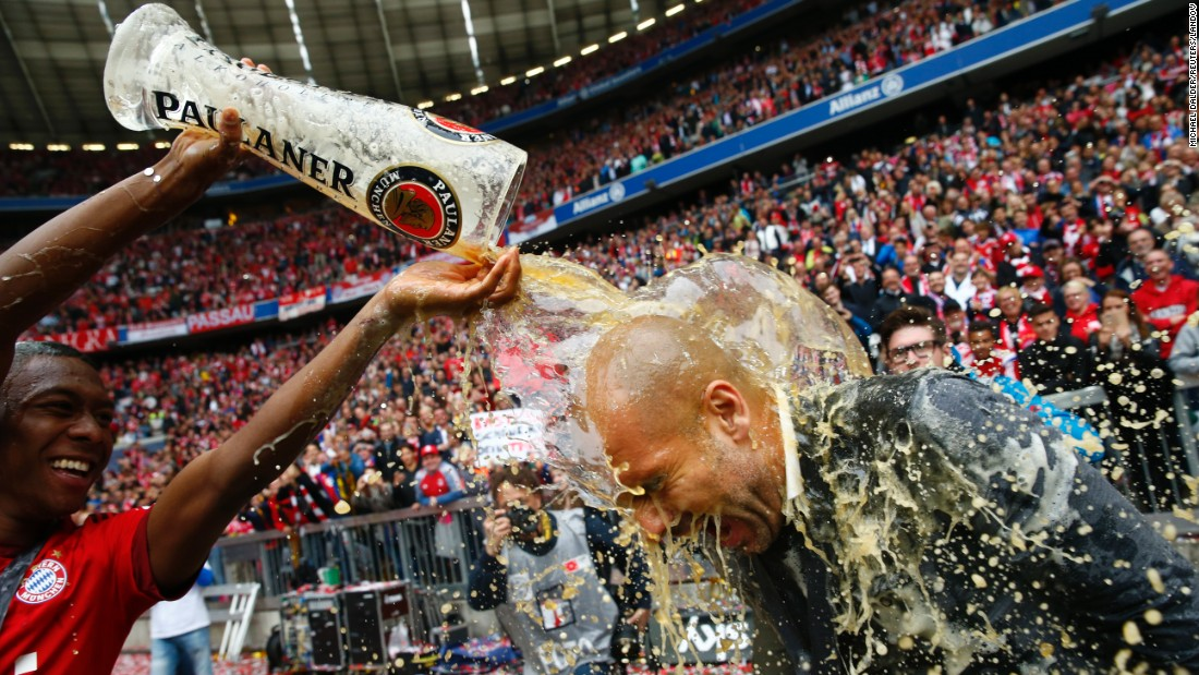 Bayern Munich's David Alaba pours beer over manager Pep Guardiola after their final Bundesliga match Saturday, May 23, in Munich, Germany. Bayern clinched the league title in late April -- its third in a row.