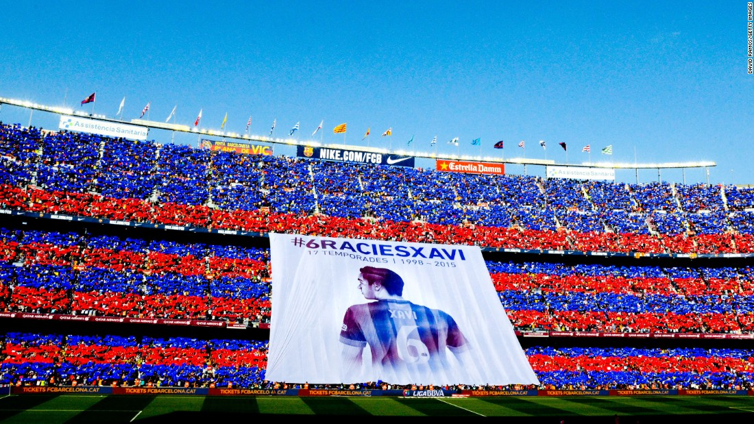 FC Barcelona fans pay tribute to Xavi, thanking the midfielder for 17 years of service, before the Spanish club's final league match of the season on Saturday, May 23. During his Barcelona career, Xavi won eight league titles and three Champions League titles.