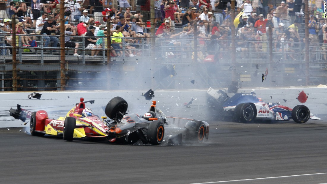 Stefano Coletti, center, hits the car driven by Sebastian Saavedra, left, during the closing laps of the Indianapolis 500 on Sunday, May 24. Jack Hawksworth, right, also hit the wall. Saavedra suffered a bruised foot in the wreck. The other two drivers were not injured.