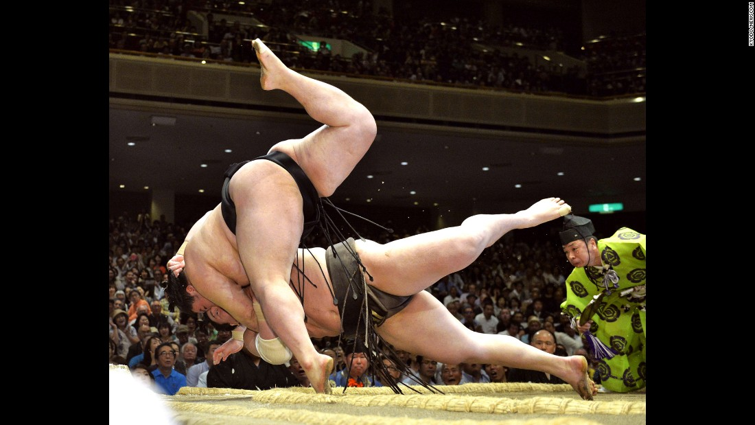 Grand champion Hakuho, bottom, is thrown down by Goeido on Thursday, May 21, during the Summer Grand Sumo Tournament in Tokyo.
