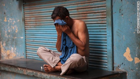 An Indian man wipes sweat off his face on a hot summer day in New Delhi, India, Sunday, May 24, 2015. Heat wave has tightened its grip over most parts of the country. More than 200 people have died since mid-April in a heat wave sweeping two southeast Indian states, Andhra Pradesh and Telangana, officials said Saturday. (AP Photo/Tsering Topgyal)