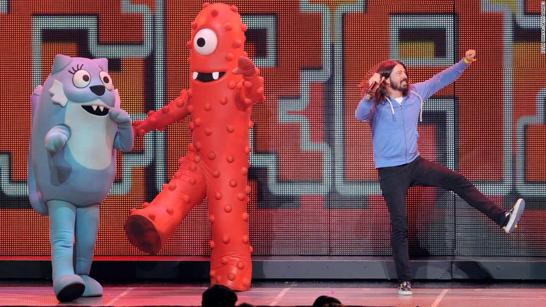 "Grohl performs with members of ""Yo Gabba Gabba!"" a children's television show, in Los Angeles in 2010."