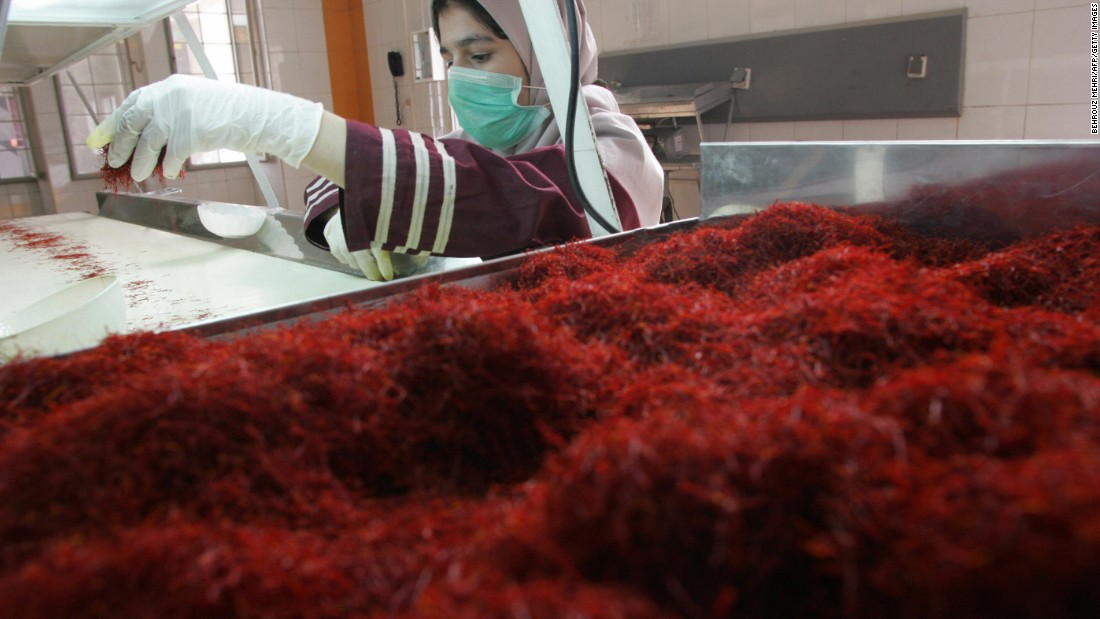 A worker sorts and cleans saffron filaments at Iran's Novin Saffron factory in Touss industrial zone in Mashhad.