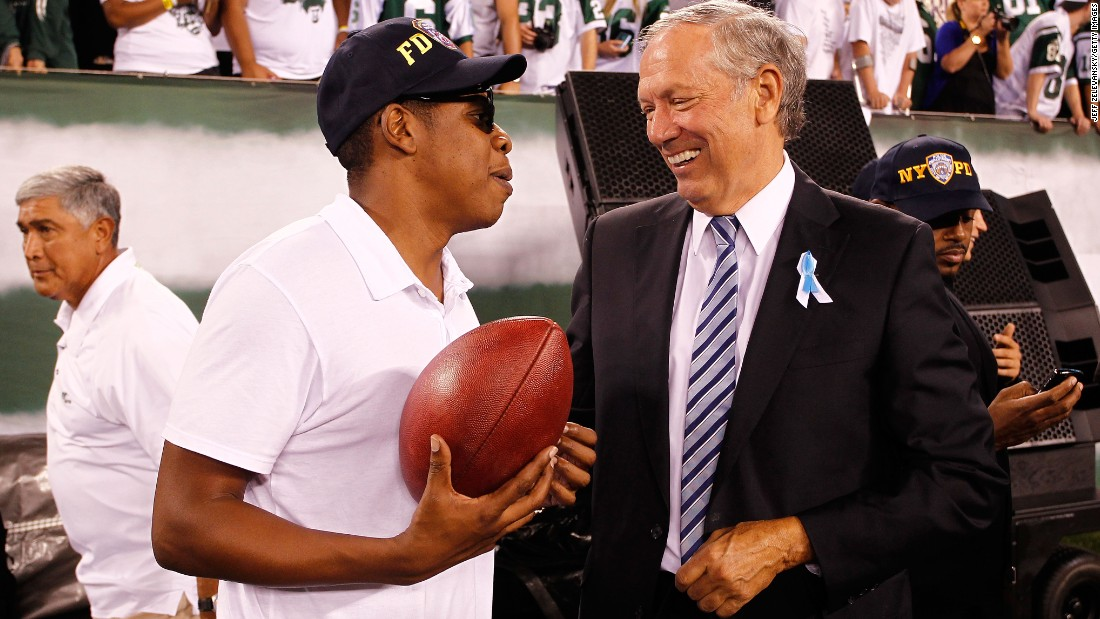 in this photo, Pataki talks with rapper Jay-Z on the sideline as the New York Jets play against the Dallas Cowboys during their NFL Season Opening Game at MetLife Stadium on September 11, 2011 in East Rutherford, New Jersey.