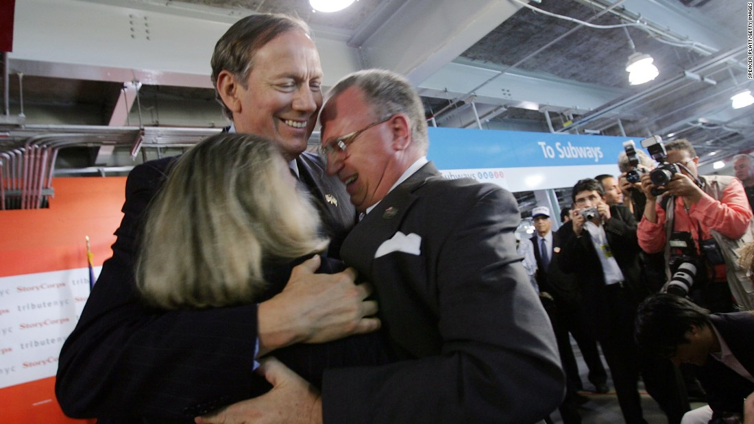 Pataki greets Alison and Jefferson Crowther, who lost their son, Welles, on September 11, during a news conference at the World Trade Center site June 16, 2005 in New York City.