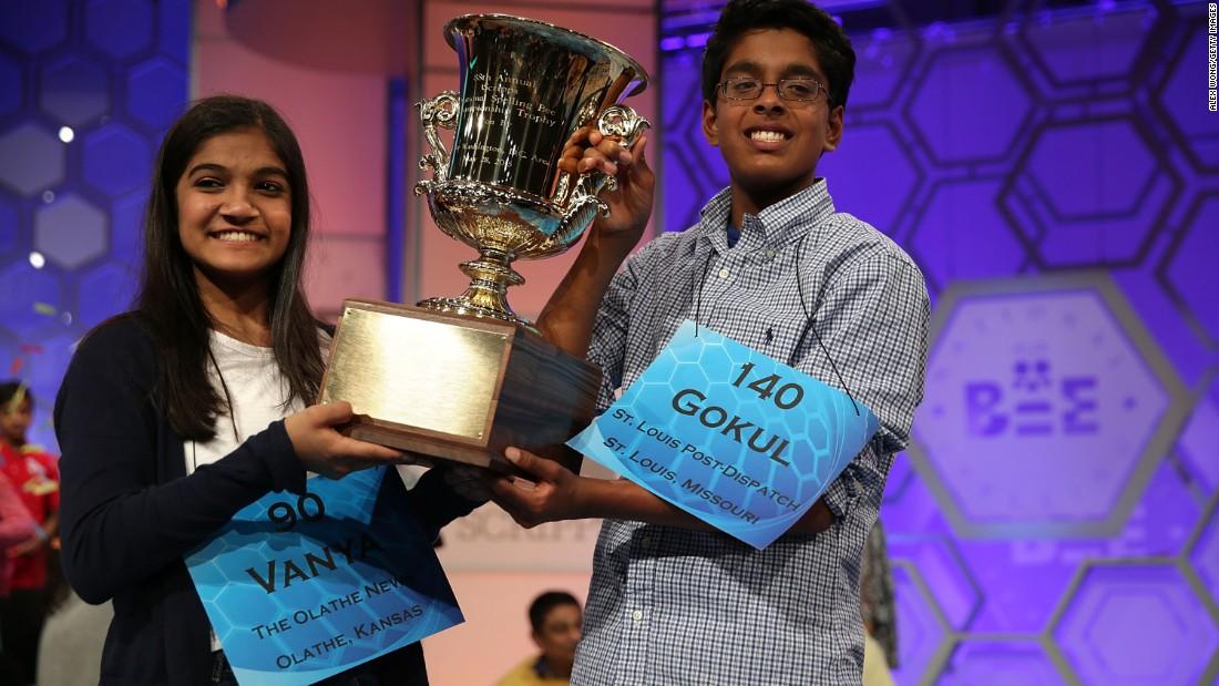 "Vanya Shivashankar, left, of Olathe, Kansas, and Gokul Venkatachalam of St. Louis hold up the trophy after being declared co-winners of the 2015 Scripps National Spelling Bee. Vanya correctly spelled the word ""scherenschnitte"" and Gokul correctly spelled the word ""nunatak."""