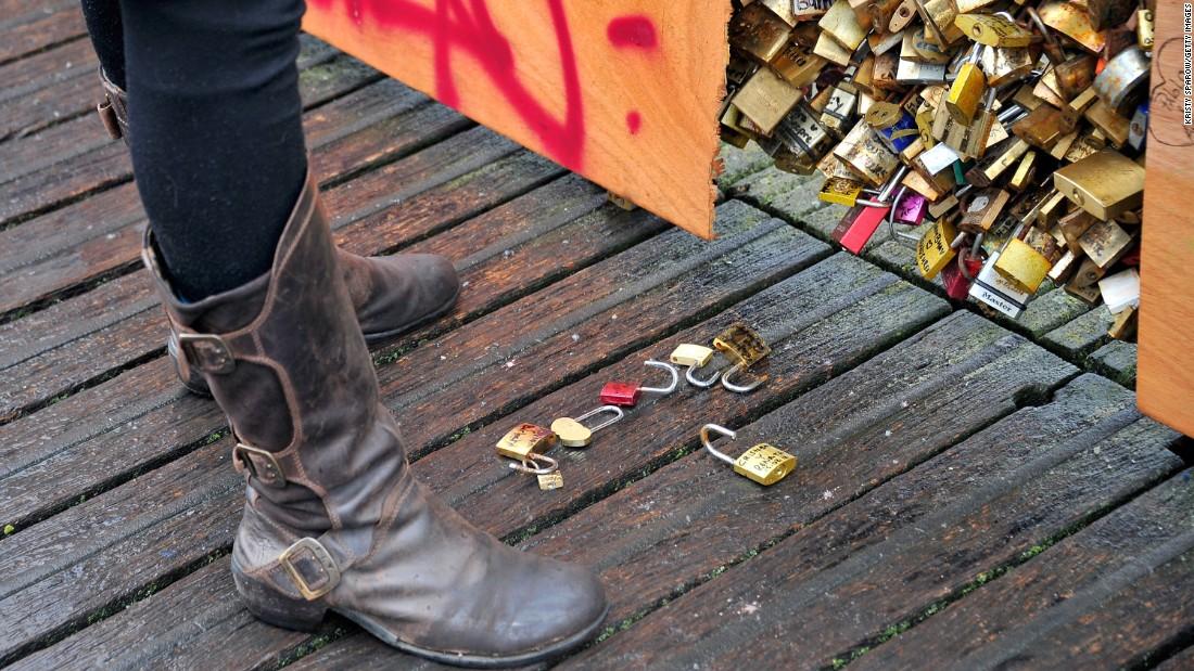 Loose locks sit on the ground near the bridge on February 14.